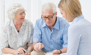 Image Of Older Couple Planning For Long-Term Care With Daughter - Rooth & Rooth Elder Law Attorneys