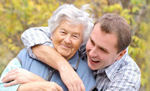 Son Hugging Elderly Mother Image For Estate Planning Lawyers - Rooth & Rooth Elder Law Attorneys
