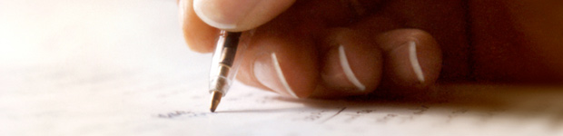 Hand holding pen and writing in Seminole, FL